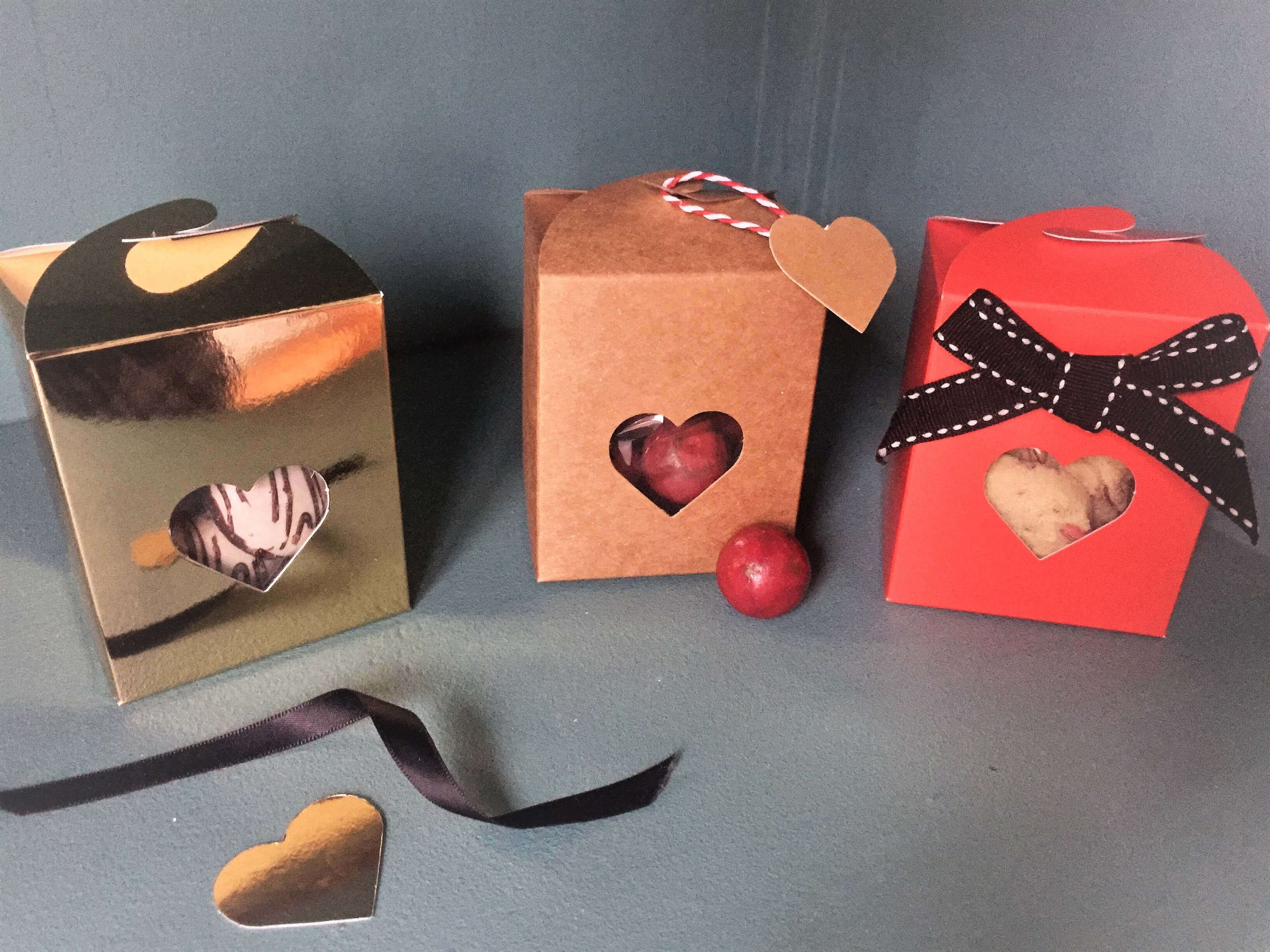 Kraft, gold, red fudge butterfly close boxes with heart window