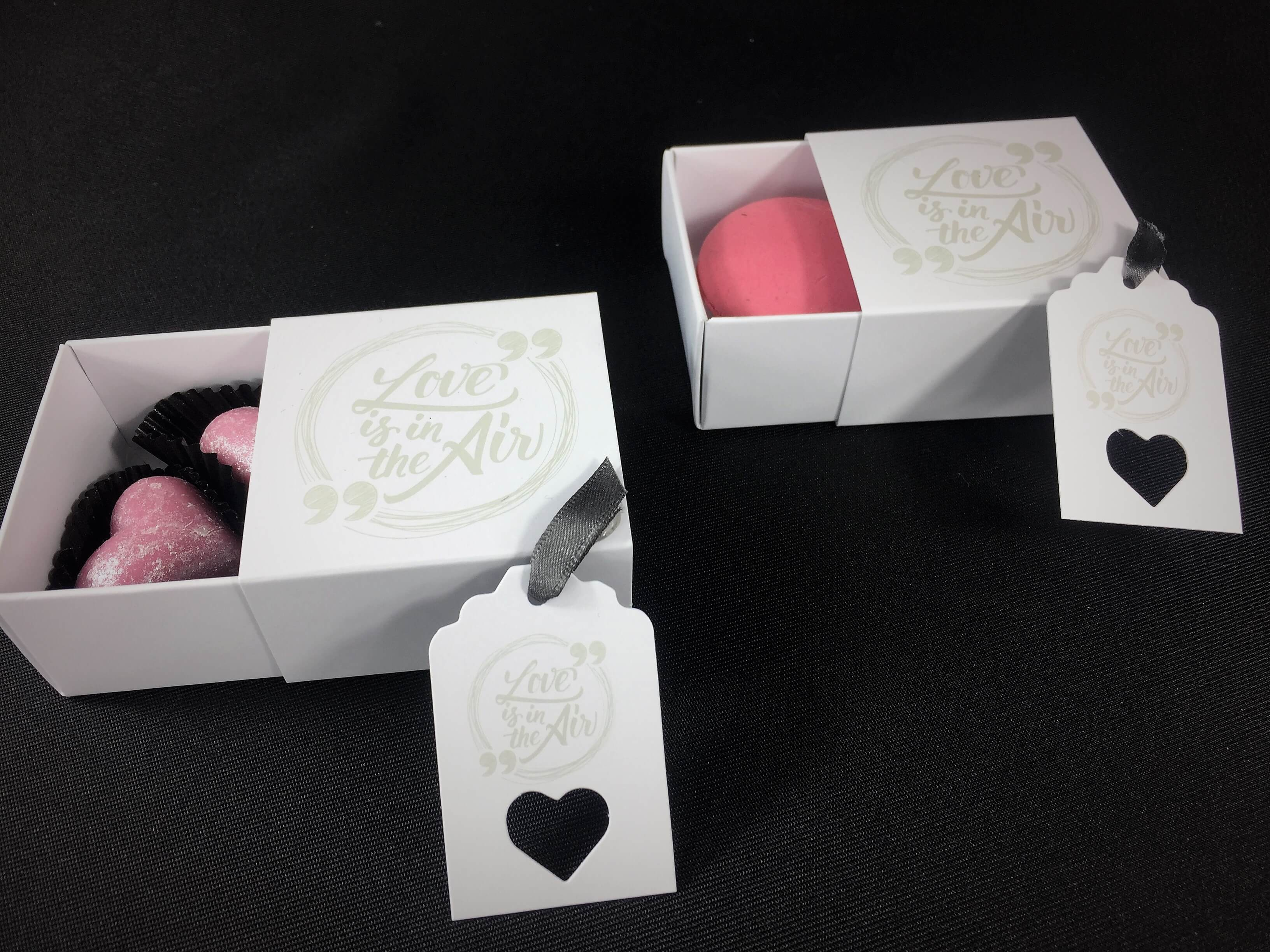 """Love is in the air"" Print sliding box with matching tag"