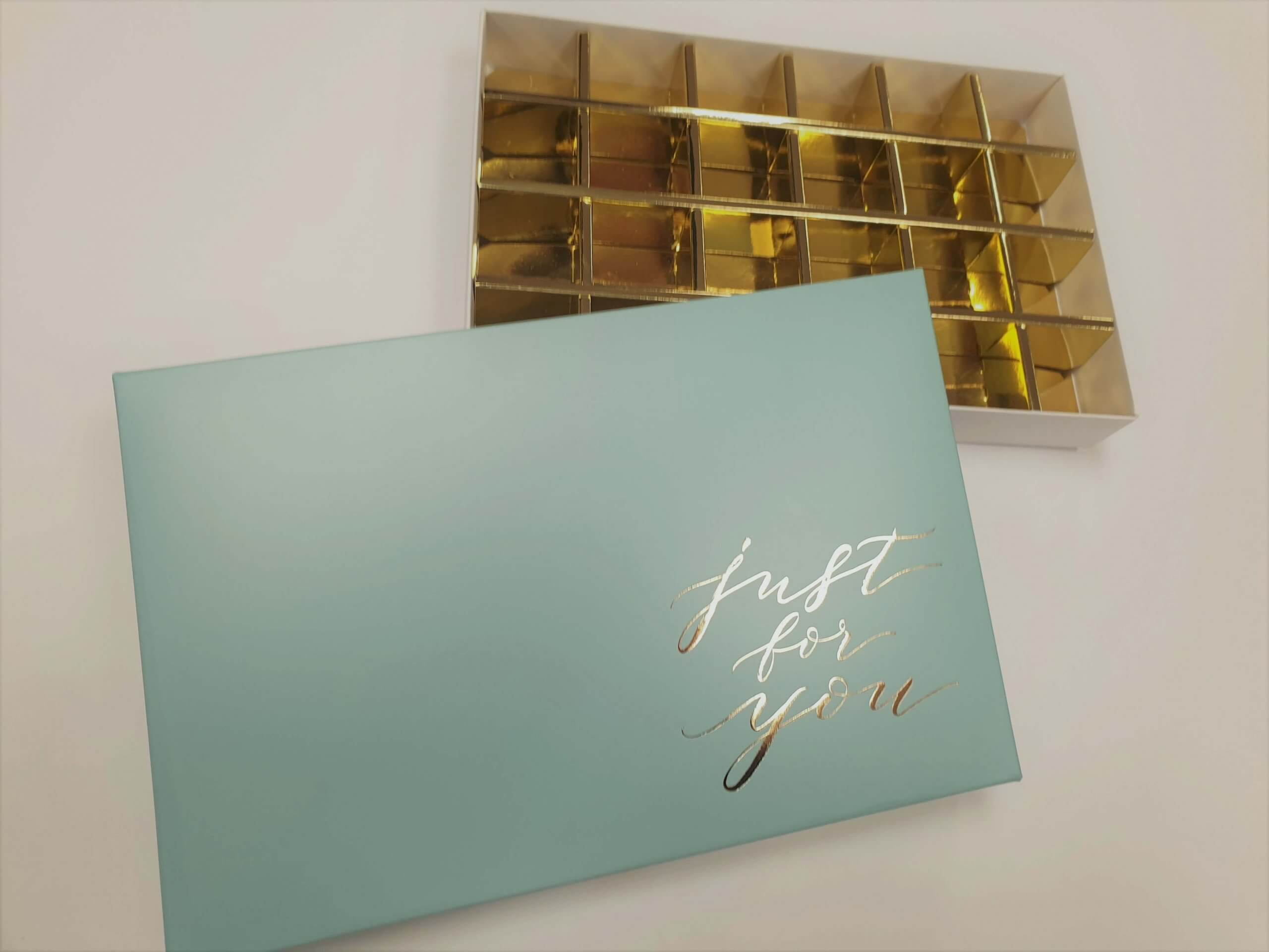 Generic blue print and hot foil 24 pack truffle box with white base & gold insert